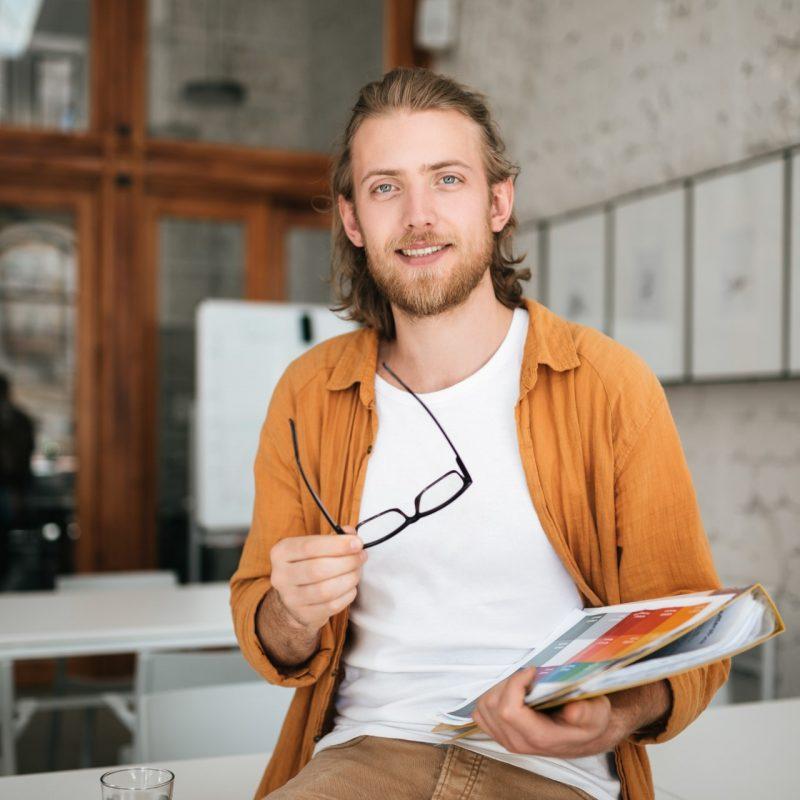 smiling-boy-with-blond-hair-and-beard-joyfully-loo-5USXMTR.jpg